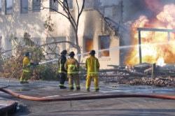 team in repairing fire damage