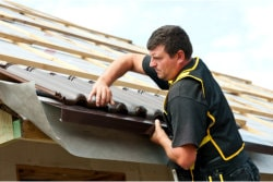 team in repairing roof damage